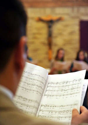 Msm Choir Member Reads Sheet Music During Rehersal
