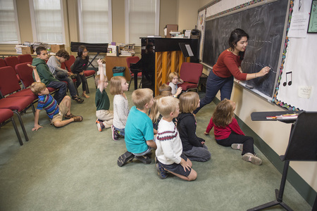 Student Teaching Children About Music